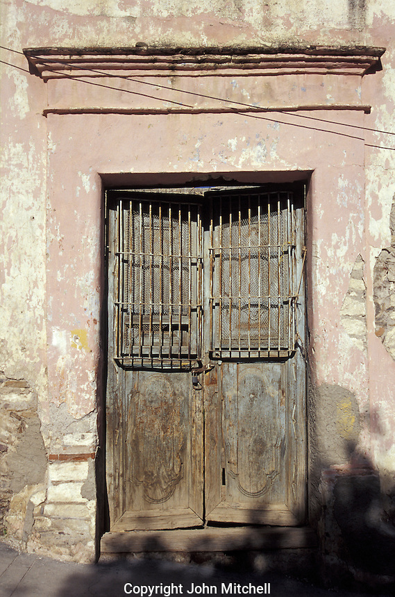 Old door the 19th-century silver-mining town of Real de Catorce, San Luis Potosi state, Mexico. Real de Catorce became a virtual ghost town during the early part of the 20th century. It has recently become a popuar destination for travellers.