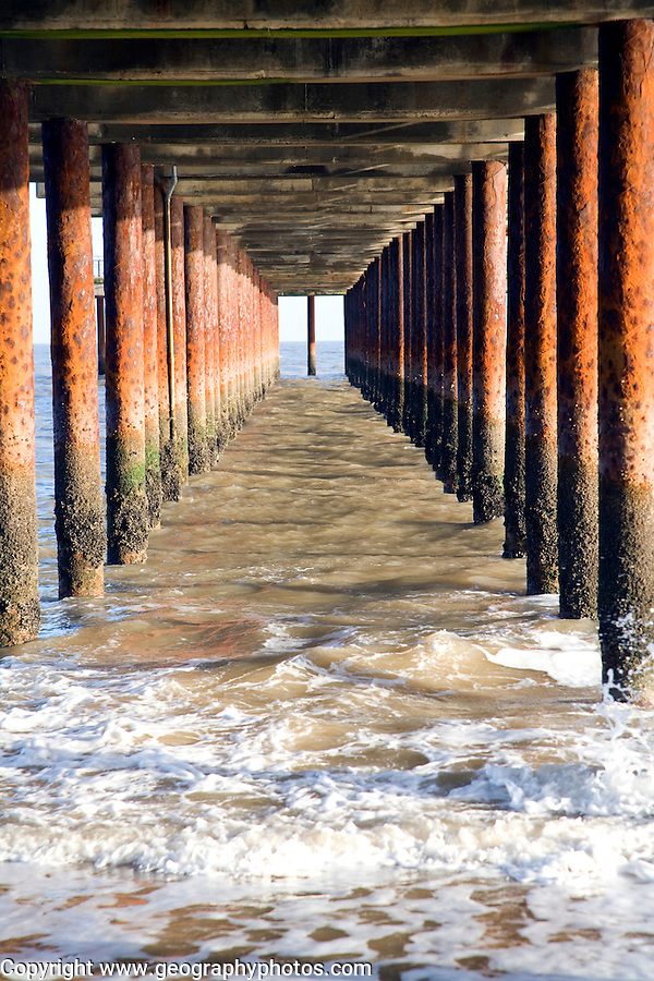 Rusty steel support pillars, Southwold pier, Southwold, Suffolk, England