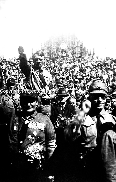 Hitler at Nazi Party rally, Nuremberg, Germany, ca.  1928.  Heinrich Hoffman Collection.  (Foreign Records Seized)<br /> Exact Date Shot Unknown<br /> NARA FILE #:  242-HAP-1928-46<br /> WAR &amp; CONFLICT BOOK #:  981