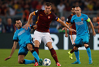 Calcio, Champions League, Gruppo E: Roma vs Barcellona. Roma, stadio Olimpico, 16 settembre 2015.<br /> Roma's Edin Dzeko, right, is challenged by FC Barcelona's Sergio Busquets during a Champions League, Group E football match between Roma and FC Barcelona, at Rome's Olympic stadium, 16 September 2015. At right, FC Barcelona's Andres Iniesta.<br /> UPDATE IMAGES PRESS/Riccardo De Luca