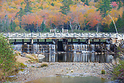 A dam on the Saco River at the Willey House Historical Site in Hart's Location of the New Hampshire White Mountains during the autumn months. The Willey House Historical site is within the scenic Crawford Notch State Park.