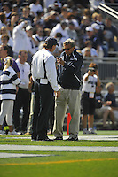 18 September 2010:  Penn State defensive coordinator Tom Bradley talks with head coach Joe Paterno.   The Penn State Nittany Lions defeated the Kent State Golden Flashes at Beaver Stadium in State College, PA..