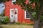 Red-Orange House with American Flag