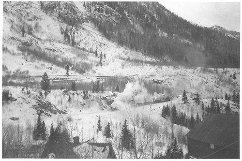 View of Ophir &amp; Ophir Loop in snow with RGS rotary train.  Taken from above the depot with its roof showing.<br /> RGS  Ophir, CO