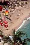 1663, Mismaloya Beach, Puerto Vallarta, Jalisco, Mexico, woman meets iguana, site of set for movie Night of the Iguana, Pacific coast, ..