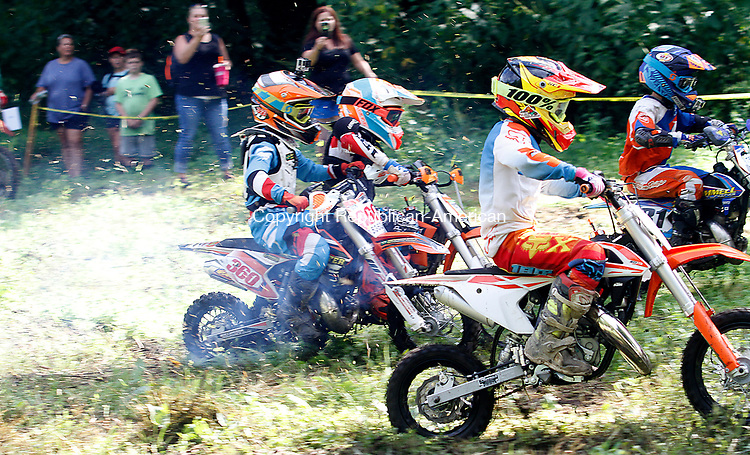 THOMASTON, CT - 19 AUGUST 2017 - 081917JW01.jpg -- 50 CC riders start their race during the Pathfinders Motorcycle Club of Connecticuts Dam Good National Hare Scramble Saturday morning at Thomaston Dam. Riding continues Sunday with the PRO/AM series. Jonathan Wilcox Republican-American