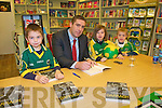 """Book Signing: Pictured with Darragh O'Shes signing his book """"My Story""""at Woulfe's Book shop in Listowel on Thuesday afternoon last were Darragh Mulvihill, Knockreagh, Listowel and Leanne & Michael Flaherty from Moyvane."""