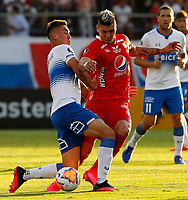 SANTIAGO DE CHILE-CHILE, 10-03-2020: Tomas Astaburuaga de Universidad Catolica y Michael Rangel de America de Cali disputan el balon durante partido de la fase de grupos, grupo E, fecha 2, entre Universidad Catolica (CHL) y America de Cali (COL) por la Copa Conmebol Libertadores 2020, en el estadio San Carlos de Apoquindo, de la ciudad Santiago de Chile. / Tomas Astaburuaga of Universidad Catolica and Michael Rangel of America de Cali vie for the ball during a match of the groups phase, group E, 2nd date, between Universidad Catolica (CHL) of America de Cali (COL) for the Conmebol Libertadores Cup 2020, at the San Carlos de Apoquindo in Santiago de Chile city. / Photo / VizzorImage / Dragomir Yankovic / Photosport / Cont.