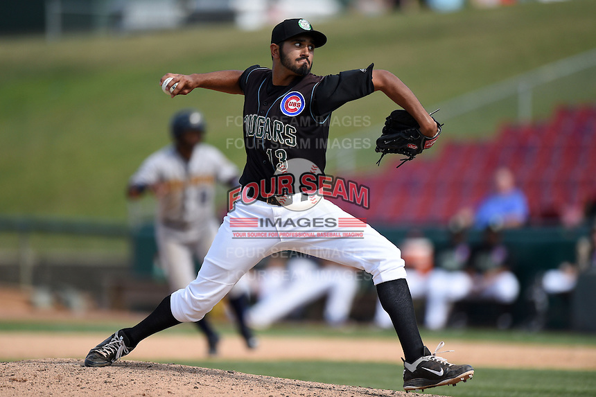 Kane County Cougars pitcher Jasvir Rakkar (13) delivers a pitch during a game against the Quad Cities River Bandits on August 20, 2014 at Third Bank Ballpark in Geneva, Illinois.  Kane County defeated Burlington 7-3.  (Mike Janes/Four Seam Images)