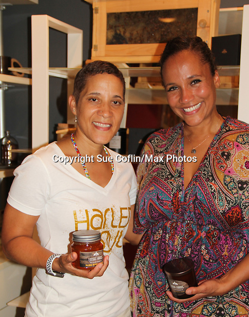 Katrina Parris (owner of NiLu) poses with Yvonna Kopacz Wright in front of Yvonna's Beewax candles - Guiding Light's Yvonna Kopacz Wright, owner of Lomar Farms in Palisades, New York where she as a beekeeper as makes beeswax candles and other products. Tonight May 4, 2018 Yvonna presented them at NiLu - gifts - lifestyle - home in Harlem where attendees viewed them, chatted, bought them. For more information go to www.lomarfarms.com. (Photo by Sue Coflin/Max Photo)