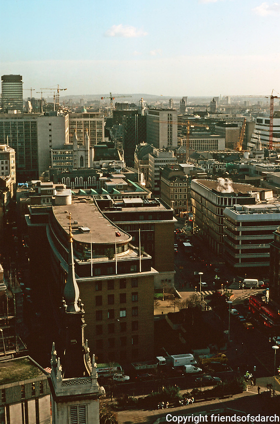 London:  5.  Panoramic view from St. Paul's.Steeple of St. Augustine's in lower foreground; Watling St. to left; Cannon St. to right.  Photo '90.