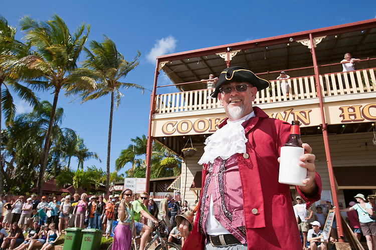 Town crier with Cooktown Hotel in background during Cooktown Discovery festival.  Cooktown, Queensland, Australia