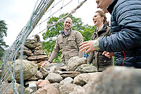 Prince William Duke of Cambridge and Kate Duchess of Cambridge Katherine Catherine Middleton take part in the repair of a dry stone wall during a visit to Deepdale Hall Farm, a traditional fell sheep farm, in Patterdale, Cumbria. Photo Credit: ALPR/AdMedia