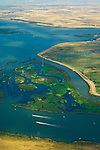 Aerial over boats and wetlands where the rivers meet in Sacramento - San Joaguin River Delta, California