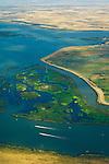 Aerial over boats and wetlands where the rivers meet in Sacramento - San Joaguin River Delta, California