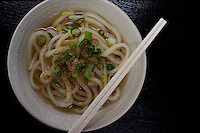 Bukkake udon, typical of Sanuki, are served in a strong splash of hot or cold dashi and topped with seasonings.