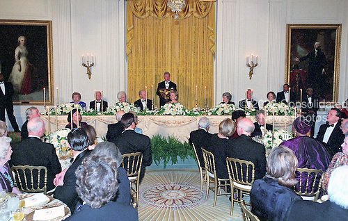 Washington, DC - November 9, 2000 -- United States President President Bill Clinton makes remarks at the 200th Anniversary of the White House Dinner held in the East Room of the White House in Washington, D.C. on November 9, 2000.  Seated at the head table in front of the President are, left to right, former first lady Betty Ford, former U.S. President Jimmy Carter, former first lady Barbara Bush, former U.S. President Gerald R. Ford, first lady Hillary Rodham Clinton, former first lady Lady Bird Johnson, former U.S. President George H.W. Bush, and former first lady Rosalynn Carter.<br /> Credit: Ron Sachs / CNP