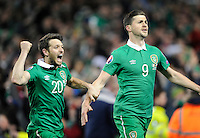 29th March 2015; UEFA EURO 2016 Championship Qualifier Group D, Ireland vs Poland, Aviva Stadium, Dublin<br /> Scorer of Republic of Ireland's equalising goal, Shane Long, celebrates with Wesley Hoolahan.<br /> Picture credit: Tommy Grealy/actionshots.ie.