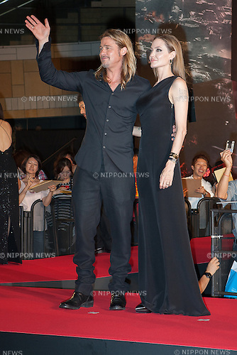 July 29, 2013, Tokyo, Japan: American actors Brad Pitt and Angelina Jolie visit Japan on the 29th of July to promote Pitt's new zombie movie World War Z. It is their first visit to Japan since late 2011. Hundreds of fans where cheering the Brangelinas walking the Red Carpet for the World War Z Movie Premiere in Tokyo. Angelina Jolie is wearing a Yves Saint Laurent dress. (Photo by Michael Steinebach/AFLO)