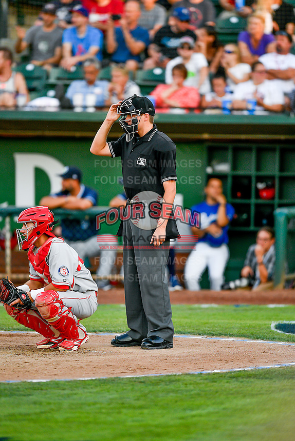 Home plate umpire Trevor Danneger handles the calls behind the plate during the 2nd Annual Northwest League-Pioneer League All-Star Game at Lindquist Field on August 2, 2016 in Ogden, Utah. The Northwest League defeated the Pioneer League 11-5. (Stephen Smith/Four Seam Images)