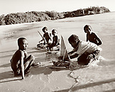 MADAGASCAR, boys playing with toy boats, Anjajavy (B&W)