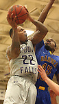 SIOUX FALLS, SD - NOVEMBER 24: Charles Ward #22 from the University of Sioux Falls takes the ball to the basket against Miguel Sansavour #45 from Dakota State University in the first half of their game Monday night at the Stewart Center.  (Photo by Dave Eggen/Inertia)