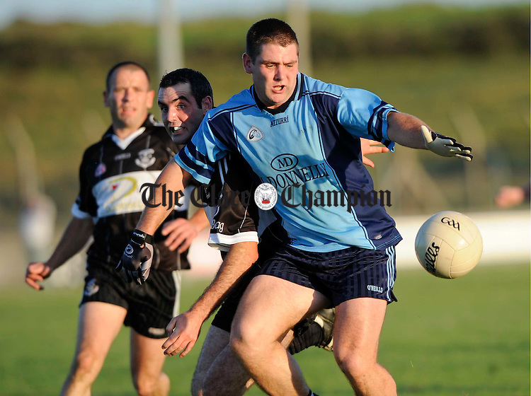 Cooraclare's Andrew O Neill is tackled by Doonbeg's David Downes during their Senior championship game at Quilty. Photograph by John Kelly.