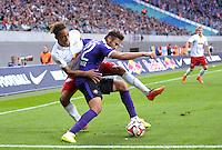 Fußball 2. Bundesliga 2014/15 - RB Leipzig gegen Erzgebirge Aue am 22.08.2014 in der Red-Bull-Arena Leipzig (Sachsen). <br /> IM BILD: Yussuf Poulsen (RB) gegen Rico Benatelli (Aue) <br /> Foto: Christian Modla