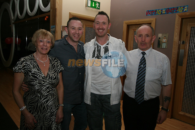 Deccie Brady (white shirt) enjoying his 40th in the Thatch Pub with his mother Breda, brother Ian and father Ken...Photo NEWSFILE/Jenny Matthews.(Photo credit should read Jenny Matthews/NEWSFILE)....This Picture has been sent you under the condtions enclosed by:.Newsfile Ltd..The Studio,.Millmount Abbey,.Drogheda,.Co Meath..Ireland..Tel: +353(0)41-9871240.Fax: +353(0)41-9871260.GSM: +353(0)86-2500958.email: pictures@newsfile.ie.www.newsfile.ie.FTP: 193.120.102.198.