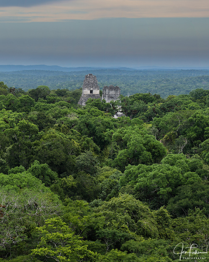 View of Temples I and II from Temple IV in the Mayan archeological site of Tikal National Park, Guatemala.  A UNESCO World Heritage site since 1979.