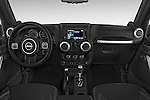 Stock photo of straight dashboard view of a 2014 Jeep Wrangler Rubicon 5 Door SUV