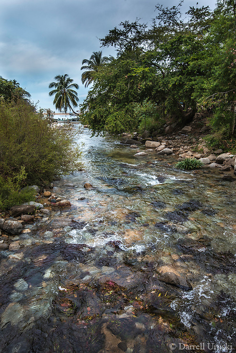 Fine Art Landscape Photograph of the Horcones river and the Boca Bay inlet that leads to a small picturesque fishing village called Boca de Tomatlán. This village is located on the Pacfic ocean side of the Mexican shoreline.