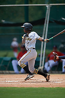 GCL Pirates shortstop Victor Ngoepe (5) follows through on a swing during a game against the GCL Braves on July 27, 2017 at ESPN Wide World of Sports Complex in Kissimmee, Florida.  GCL Braves defeated the GCL Pirates 8-6.  (Mike Janes/Four Seam Images)