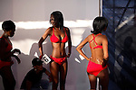 SOWETO, SOUTH AFRICA SEPTEMBER 23: Participants in a beauty contest waits backstage to enter the stage on September 23, 2006 in Soweto, Johannesburg, South Africa. The competition was part of Soweto festival. Soweto is South Africa?s largest township and it was founded about one hundred years to make housing available for black people south west of downtown Johannesburg. The estimated population is between 2-3 million. Many key events during the Apartheid struggle unfolded here, and the most known is the student uprisings in June 1976, where thousands of students took to the streets to protest after being forced to study the Afrikaans language at school. Soweto today is a mix of old housing and newly constructed townhouses. A new hungry black middle-class is growing steadily. Many residents work in Johannesburg but the last years many shopping malls have been built, and people are starting to spend their money in Soweto.  .(Photo by Per-Anders Pettersson/Getty Images).