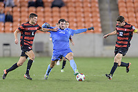 Houston, TX -  Friday, December 9, 2016: Tucker Hume (36) of the North Carolina Tar Heels attempts to dribble the ball between Thomas Hilliard-Arce (4) and Drew Skundrich (12) of the Stanford Cardinal  at the  NCAA Men's Soccer Semifinals at BBVA Compass Stadium.