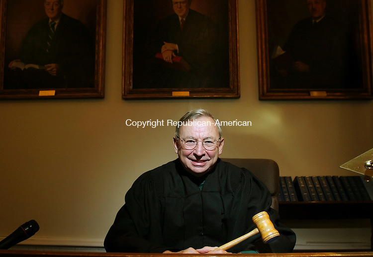 TORRINGTON,  CT 10 October 2005 -101005BZ02-     <br /> Judge Charles Gill, holding a gavel his father used as President of the Board of Police Commissioners in New Haven,  poses on the bench inside the Litchfield Superior Courthouse Monday afternoon. <br /> Jamison C. Bazinet / Republican-American