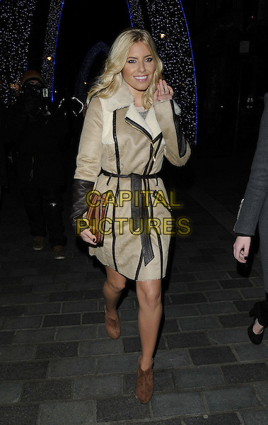 Mollie King of The Saturdays .The Supertrash store launch party, Supertrash, South Molton St., London, England..November 21st, 2012.full length beige brown black sheepskin mac jacket brown shoes clutch bag belted hand arm waving .CAP/CAN.©Can Nguyen/Capital Pictures.