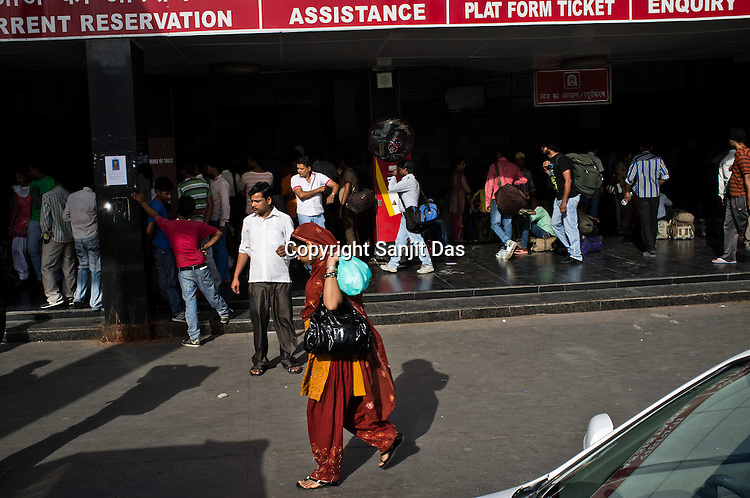 Travellers seen outside the busy New Delhi Railway Station in New Delhi, India. Photo: Sanjit Das/Panos