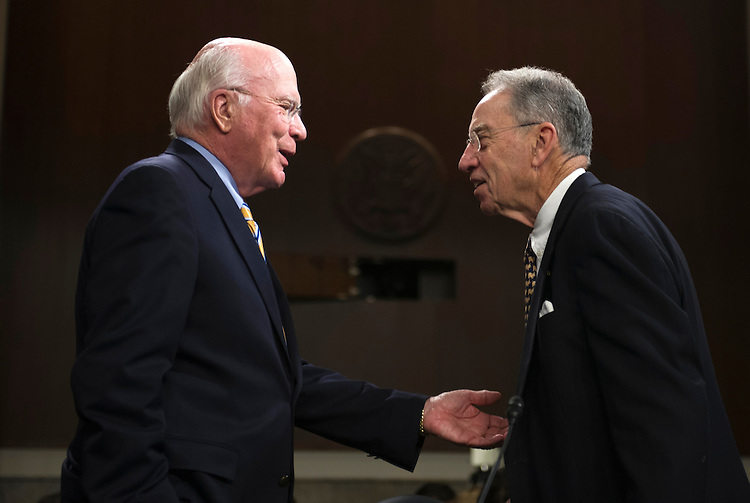 UNITED STATES - May 14: Chairman Pat Leahy, D-Vt., left, has a word with Sen. Chuck Grassley, R-Iowa, ranking member,  prior to the start of the Senate Judiciary Committee hearing on the continued consideration of the border security, economic opportunity and immigration modernization act on Capitol Hill May 14, 2013 in Washington, DC. The 18 members of the committee have proposed in excess of 300 amendments to the 844 page piece of legislation that would, if passed, create a path to U.S. citizenship for undocumented immigrants. (Photo By Douglas Graham/CQ Roll Call)