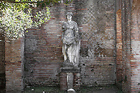 Woman sitting on a throne, Domus della Fortuna Annonaria (House of the Fortuna Anonaria), 2nd century AD, Ostia Antica, Italy. Her head is turreted and she is holding a cornucopia in her left hand. It has been thought that she represents the Fortuna Annonaria (Fortuna of the grain-supply) or a personnification of the city of Ostia. Picture by Manuel Cohen