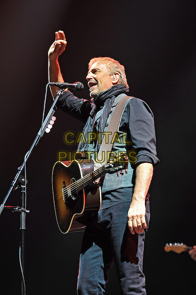 Kevin Costner .Kevin Costner & Modern West Live in concert, Saint Petersburg, Russia, April 11th 2013..on stage gig music performing half length grey gray black top waistcoat scarf shirt guitar arm raised up singing waving hand .CAP/PER/VB.©VB/PersonaStars/CapitalPictures