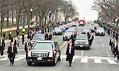 President Donald Trump's limo moves along the route of the inaugural parade flanked by security on January 20, 2017 in Washington, D.C.  Trump became the 45th President of the United States.   <br /> Credit: Kevin Dietsch / Pool via CNP