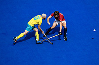 2nd February 2020; Sydney Olympic Park, Sydney, New South Wales, Australia; International FIH Field Hockey, Australia versus Great Britain; Matthew Swann of Australia passes the ball as Will Calnan of Great Britain tackles