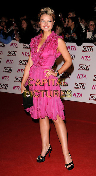 EMMA RIGBY.The National Television Awards held at the Royal Albert Hall, London, England, 29th October 2008. .NTA red carpet arrivals full length fuschia pink dress matthew Williamson black shoes clutch bag hand on hip ruffled ruffles .CAP/CAN.©Can Nguyen/Capital Pictures.