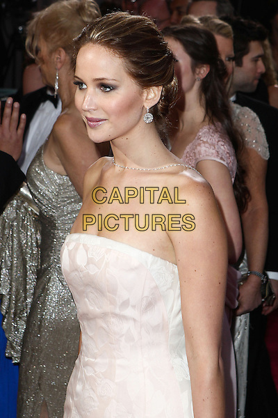 Jennifer Lawrence (wearing Dior Haute Couture).85th Annual Academy Awards held at the Dolby Theatre at Hollywood & Highland Center, Hollywood, California, USA..February 24th, 2013.oscars half length white pale pink strapless dress gown .CAP/ADM/SLP/COL.©Colin/StarlitePics/AdMedia/Capital Pictures