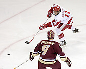 Jake Dowell 11 of the University of Wisconsin moves the puck.  The Boston College Eagles defeated the University of Wisconsin Badgers 3-0 on Friday, October 27, 2006, at the Kohl Center in Madison, Wisconsin in their first meeting since the 2006 Frozen Four Final which Wisconsin won 2-1 to take the national championship.<br />
