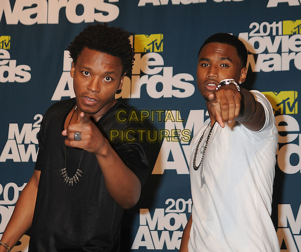 Lupe Fiasco, Trey Songz.in the Press Room at the 2011 MTV Movie Awards at Universal Studios' Gibson Amphitheatre in Universal City, California, USA, June 5th 2011.  .pressroom full length hand salute white t-shirt jeans  hand fingers pointing .CAP/ROT/TM.©TM/Roth Stock/Capital Pictures