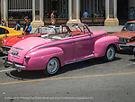 1940's pink Ford near Grand Theatre of Havana