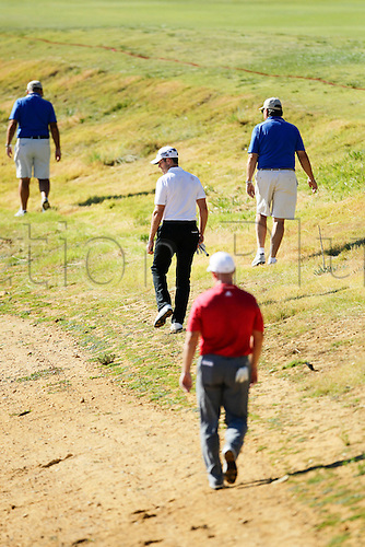 27.02.2016. Perth, Australia. ISPS HANDA Perth International Golf. Stuart Manley (WAL) and Peter Lonard (AUS) looks for Manleys ball he hit it out of bounds from the third tee during day three.