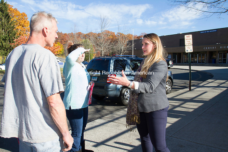 WATERBURY, CT - 08 NOVEMBER 2016 - 110816JW07.jpg -- Chris Macalinden and Bridget Bioski listen to 74th District State Representative Republican Candidate Stephanie Cummings before voting at Crosby High School Tuesday afternoon.    Jonathan Wilcox Republican-American